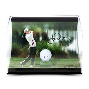 Rory McIIroy Autographed Holding the Finish Picture with Range Driven Ball